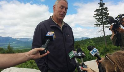 "Interior Secretary Ryan Zinke talks with reporters with part of Mount Katahdin in the background at the Katahdin Woods And Waters National Monument near Staceyville, Maine, Wednesday, June 14, 2017. Zinke praised the beauty of the national monument Wednesday and said he's ""comfortable"" with the National Park Service property remaining in public hands. (AP Photo/Patrick Whittle)"
