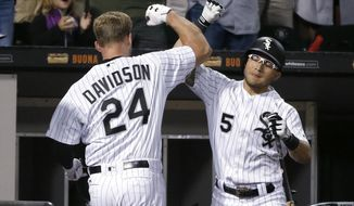 Chicago White Sox's Matt Davidson (24) celebrates his home run with Yolmer Sanchez during the second inning of a baseball game against the Baltimore Orioles Wednesday, June 14, 2017, in Chicago. (AP Photo/Charles Rex Arbogast)