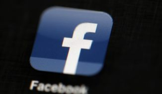 The Facebook logo is displayed on an iPad in Philadelphia on May 16, 2012. (Associated Press) **FILE**
