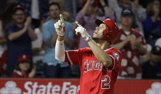 Los Angeles Angels' Andrelton Simmons points upward after hitting a two-run home run during the seventh inning of the team's baseball game against the New York Yankees, Wednesday, June 14, 2017, in Anaheim, Calif. (AP Photo/Jae C. Hong)