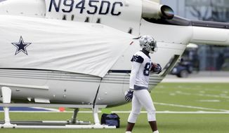 Dallas Cowboys wide receiver Dez Bryant (88) walks by the private helicopter of team owner Jerry Jones after catching a pass on the practice field during NFL football practice at the team's training facility, Wednesday, June 14, 2017, in Frisco, Texas. (AP Photo/Tony Gutierrez)