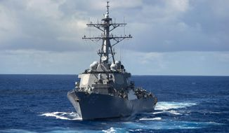In this Aug. 20, 2013 photo, the guided-missile destroyer USS Fitzgerald (DDG 62) makes its way through the Pacific Ocean. The U.S. military said the Navy destroyer collided with a merchant ship off the coast of Japan and said there have been injuries. In a brief written statement, U.S. Pacific Fleet in Hawaii said the Navy has requested assistance from the Japanese Coast Guard.  (Mass Communication Specialist 3rd Class Paul Kelly/U.S. Navy via AP)