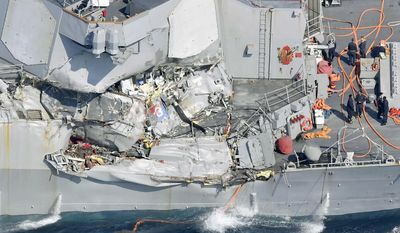 The damage of the right side of the USS Fitzgerald is seen off Shimoda, Shizuoka prefecture, Japan, after the Navy destroyer collided with a merchant ship, Saturday,  June 17, 2017.   Seven Navy sailors are missing and one was injured after a U.S. destroyer collided early Saturday morning with the Philippine-registered container ship  off the coast of Japan, the country's coast guard reported. (Iori Sagisawa/Kyodo News via AP)