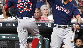 Boston Red Sox' Mookie Betts (50) celebrates his go-ahead solo home run off Houston Astros relief pitcher Will Harris with Xander Bogaerts during the eighth inning of a baseball game, Friday, June 16, 2017, in Houston. (AP Photo/Eric Christian Smith)