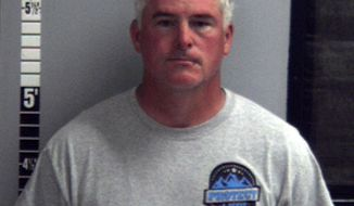 This June 15, 2017, booking photo provided by the Helena Police Department shows Cascade County Sheriff Bob Edwards. Edwards was arrested in Helena, Mont., on a misdemeanor charge of partner or family member assault after his girlfriend reported he pushed her into a TV stand in a hotel room. Edwards was in Helena for the Montana Sheriffs and Peace Officers Association annual convention. (Helena Police Department via AP)
