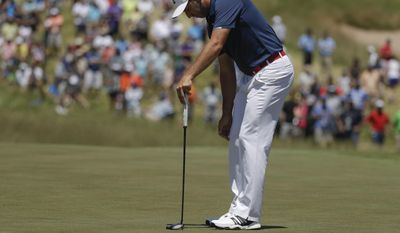 Sergio Garcia, of Spain, reacts after putting on the ninth hole during the second round of the U.S. Open golf tournament Friday, June 16, 2017, at Erin Hills in Erin, Wis. (AP Photo/Chris Carlson)