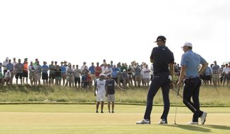 The last two U.S. Open champions, Dustin Johnson, left, and Jordan Spieth talk on the 10th green during the first round of the U.S. Open golf tournament, Thursday, June 15, 2017, at Erin Hills in Erin, Wis. (John Ehlke/West Bend Daily News via AP)