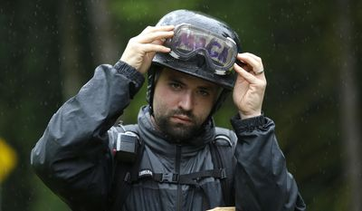 "Joey Nation, a protester with the conservative group Patriot Prayer, adjusts his goggles over tape with the abbreviation of President Donald Trump's slogan ""MAGA"" (Make America Great Again) on his helmet as he prepares for a protest, Thursday, June 15, 2017, at Evergreen State College in Olympia, Wash. (AP Photo/Ted S. Warren)"