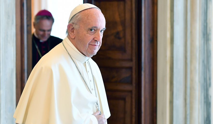 Pope Francis looks on after his private audience with German Chancellor Angela Merkel, at the Vatican, Saturday, June 17, 2017. (Ettore Ferrari/Pool Photo via AP)