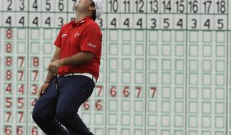 Patrick Reed reacts after missing a birdie putt on the 18th hole during the third round of the U.S. Open golf tournament Saturday, June 17, 2017, at Erin Hills in Erin, Wis. (AP Photo/David J. Phillip)