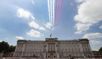 The Red Arrows fly past as Britain's Royals watch from the balcony of Buckingham Palace, after the annual Trooping the Colour Ceremony in London, Saturday, June 17, 2017. (AP Photo/Kirsty Wigglesworth)