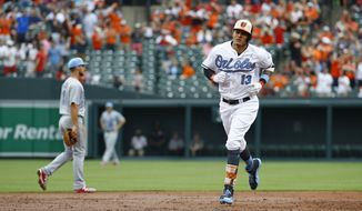 Baltimore Orioles' Manny Machado rounds the bases after hitting a two-run home run in the second inning of an interleague baseball game against the St. Louis Cardinals in Baltimore, Saturday, June 17, 2017. (AP Photo/Patrick Semansky)