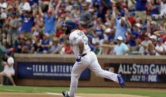 Fans stand and cheer as Texas Rangers' Mike Napoli rounds first watching his two-run home run that came off a pitch fromSeattle Mariners starting pitcher Yovani Gallardo in the first inning of a baseball game, Saturday, June 17, 2017, in Arlington, Texas. The shot scored Carlos Gomez. (AP Photo/Tony Gutierrez)