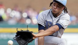 Tampa Bay Rays pitcher Chris Archer (22) snags a hard-hit grounder from Detroit Tigers' Jose Iglesias and throws him out during the fifth inning of a baseball gam, Saturday, June 17, 2017, in Detroit. (AP Photo/Duane Burleson)