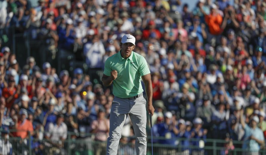 Brooks Koepka reacts on the 18th hole during the fourth round of the U.S. Open golf tournament Sunday, June 18, 2017, at Erin Hills in Erin, Wis. (AP Photo/Chris Carlson)