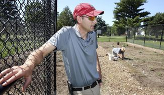 In this June 2017 photo, Brian Hickey, golf maintenance manager at the Palmer Hills Golf Course in Bettendorf, talks about the recently planted vegetable garden, in Bettendorf, Iowa. Hickey indicated the produce will be served at the Palmer Grill during the entire growing season. (Kevin E. Schmidt/Quad City Times via AP)