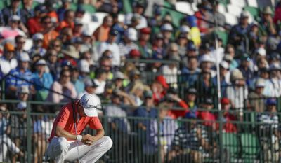 Justin Thomas reacts on the 18th hole during the fourth round of the U.S. Open golf tournament Sunday, June 18, 2017, at Erin Hills in Erin, Wis. (AP Photo/Chris Carlson)