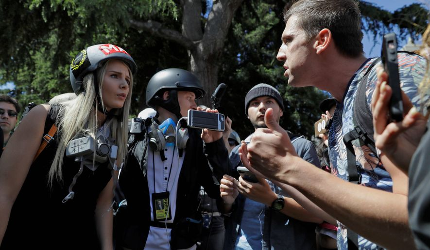 Demonstrators with opposing views argue at a free speech rally on the University of California, Berkeley campus. Despite political differences, 76 percent say there's a greater danger of political violence today. (Associated Press)