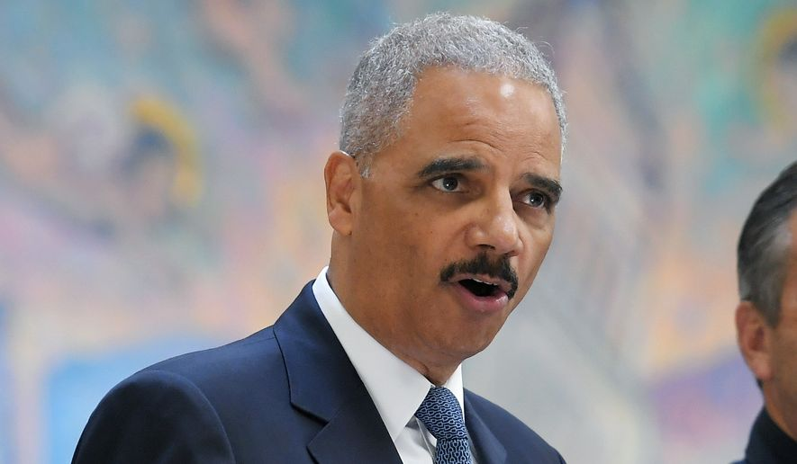 """Former U.S. Attorney General Eric Holder, speaks at a news conference to discuss the proposed so-called California """"sanctuary state bill"""", Monday, June 19, 2017, in Los Angeles. Holder said Monday he believes cutting funding from so-called sanctuary cities would be unconstitutional. (AP Photo/Mark J. Terrill)"""