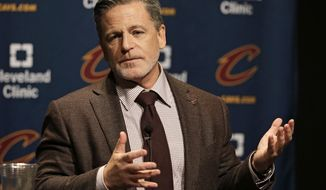 FILE - In this Friday, Oct. 30, 2015, file photo, Cleveland Cavaliers owner Dan Gilbert answers a question before an NBA basketball game between the Miami Heat and the Cleveland Cavaliers in Cleveland. Cleveland Cavaliers general manager David Griffin have decided to part ways following three consecutive trips to the NBA Finals. Gilbert said in a statement Monday, June 19, 2017, that the Cavaliers will not extend Griffin's current contract when it expires June 30. (AP Photo/Tony Dejak, File)