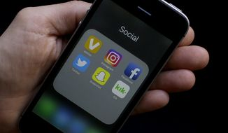 This June 16, 2017, photo shows social media app icons on a smartphone held by an Associated Press reporter in San Francisco. Google yourself. Curate your online photos. And as one private high school advises its students: Don't post anything online you wouldn't want your grandmother to see. AP spoke with experts on the role of social media in the college admissions process. They offered tips for students on what to post - and not post - if you're trying to get into college. (AP Photo/Jeff Chiu)