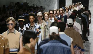 Models wear creations part of the Fendi men's Spring-Summer 2018 collection, that was presented in Milan, Italy, Monday, June 19, 2017. (AP Photo/Luca Bruno)