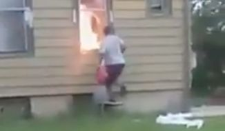 Milwaukee police are searching for a woman seen in a Facebook video intentionally setting a house fire that killed a 72-year-old man. (Facebook/@The People's Content)