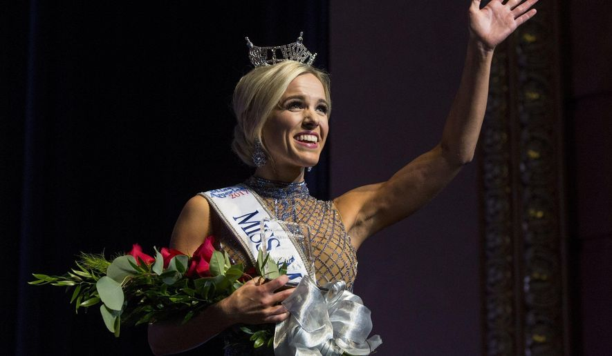 Miss Washtenaw County Heather Kendrick waves after being recognized as Miss Michigan 2017 during the finale of the Miss Michigan Scholarship Pageant at Frauenthal Center on Saturday, June 17, 2017 in Muskegon, Mich. (Youngrae Kim/Muskegon Chronicle via AP)