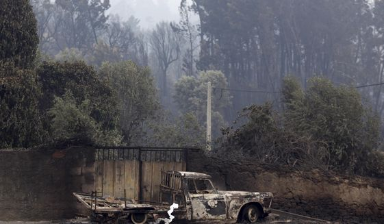 A burnt truck next to a gate in the village of Pobrais, near Pedrogao Grande, central Portugal, Monday, June 19 2017. More than 2,000 firefighters in Portugal battled Monday to contain major wildfires in the central region of the country, where one blaze killed 62 people, while authorities came under mounting criticism for not doing more to prevent the tragedy. (AP Photo/Armando Franca)