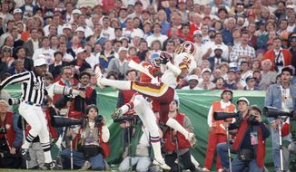 Washington Redskins Barry Wilburn (45) intercepts pass by Denver Broncos John Elway in second quarter of Super Bowl, Sunday, Jan. 31, 1988 in San Diego. Pass was intended for Ricky Nattiel (84) who?s going up for ball with Wilburn. Redskins had a 35-10 halftime lead. (AP Photo/Bob Galbraith)