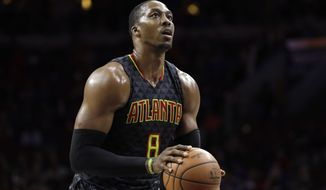 FILE - In this March 29, 2017, file photo, Atlanta Hawks' Dwight Howard prepares to shoot a free throw during the team's NBA basketball game against the Philadelphia 76ers in Philadelphia. A person familiar with the situation says the Charlotte Hornets have reached an agreement to acquire center Howard from the Hawks. The Hawks are sending Howard and the No. 31 overall pick in Thursday's NBA draft to Charlotte for center Miles Plumlee, shooting guard Marco Belinelli and the 41st pick, the person told The Associated Press on condition of anonymity Tuesday, June 20, because the trade is not yet official. (AP Photo/Matt Slocum, File)