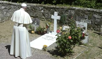Pope Francis prays in front of the tomb of Don Lorenzo Milani, in Barbiana, near Florence,  Italy, Tuesday, June 20, 2017. Pope Francis is making a pilgrimage to northern Italy to honor two 20th-century parish priests, Don Primo Mazzolari and Don Lorenzo Milani, whose commitment to the poor and powerless brought them censure from the Vatican.. (L'Osservatore Romano/Pool Photo via AP)