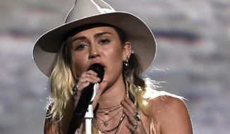"""Miley Cyrus performs """"Malibu"""" at the Billboard Music Awards at the T-Mobile Arena on Sunday, May 21, 2017, in Las Vegas. (Photo by Chris Pizzello/Invision/AP)"""
