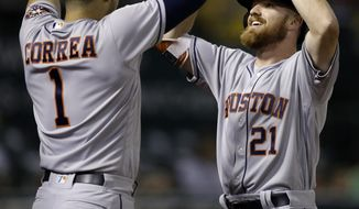 Houston Astros' Derek Fisher right, celebrates with Carlos Correa (1) after hitting a home run off Oakland Athletics' Josh Smith in the ninth inning of a baseball game Monday, June 19, 2017, in Oakland, Calif. (AP Photo/Ben Margot)