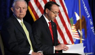 Attorney General Jeff Sessions, left, and Deputy Attorney General Rod Rosenstein take their seats at the Justice Department's National Summit on Crime Reduction and Public Safety, in Bethesda, Md., on Tuesday, June 20, 2017. (AP Photo/Jacquelyn Martin)