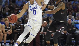 FILE - In this March 19, 2017, file photo, Duke's Jayson Tatum, left, drives past South Carolina's Chris Silva during the first half in a second-round game of the NCAA men's college basketball tournament, in Greenville, S.C. Tatum spent one season at Duke and is expected to be a top-five pick in Thursday's NBA draft. (AP Photo/Rainier Ehrhardt, File)