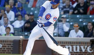 Chicago Cubs' Anthony Rizzo swings into a lead off home run against San Diego Padres starting pitcher Jhoulys Chacin during the first inning of a baseball game Tuesday, June 20, 2017, in Chicago. (AP Photo/Charles Rex Arbogast)