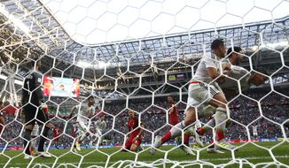 Mexico's Hector Moreno, right, celebrates with his teammates scoring his side's second goal during the 2017during the Confederations Cup, Group A soccer match between Portugal and Mexico, at the Kazan Arena, Russia, Sunday, June 18, 2017. (AP Photo/Martin Meissner)