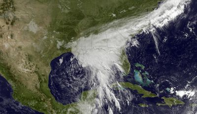 This satellite image taken Tuesday, June 20, 2017, and released by the National Oceanic and Atmospheric Administration shows a tropical storm over the Gulf of Mexico approaching the Gulf Coast. Tropical Storm Cindy hovered over the Gulf of Mexico south of Louisiana on Tuesday, churning tides and spinning bands of rain over the central and eastern Gulf Coast. (NOAA via AP)