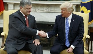 President Donald Trump shakes hands with Ukrainian President Petro Poroshenko during a meeting in the Oval Office of the White House, Tuesday, June 20, 2017, in Washington. (AP Photo/Evan Vucci)