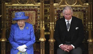 Britain's Queen Elizabeth II and Prince Charles sit in the House of Lords at the official State Opening of Parliament in London, Wednesday, June 21, 2017. Queen Elizabeth II goes to parliament Wednesday to outline the government's legislative program with far less pageantry than usual in a speech expected to be dominated by Britain's plans for leaving the European Union. (Carl Court/Pool via AP)