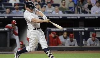 New York Yankees' Matt Holliday hits a home run during the fifth inning of the team's baseball game against the Los Angeles Angels on Wednesday, June 21, 2017, in New York. (AP Photo/Frank Franklin II)