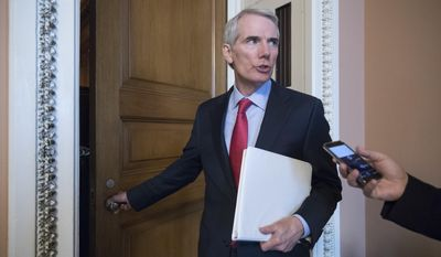 "Sen. Rob Portman, R-Ohio, pauses for a reporter's question as he arrives at a closed-door GOP strategy session on the Republican health care overhaul with Vice President Mike Pence, Senate Majority Leader Mitch McConnell, R-Ky., and others, at the Capitol in Washington, Tuesday, June 20, 2017. Sen. McConnell says Republicans will have a ""discussion draft"" of a GOP-only bill scuttling former President Barack Obama's health care law by Thursday. (AP Photo/J. Scott Applewhite)"
