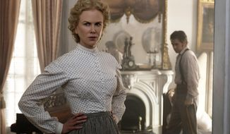 """This image released by Focus Features shows Nicole Kidman, left, and Colin Farrell in a scene from """"The Beguiled."""" (Ben Rothstein/Focus Features via AP)"""