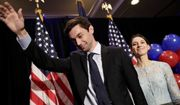 Democratic candidate for 6th congressional district Jon Ossoff, left, waves to the crowd while stepping offstage with his fiancee Alisha Kramer after conceding to Republican Karen Handel at his election night party in Atlanta, Tuesday, June 20, 2017. (AP Photo/David Goldman)