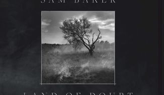 "This cover image released by Blue Limestone shows ""Land of Doubt,"" a release by sam Baker. (Blue Limestone via AP)"
