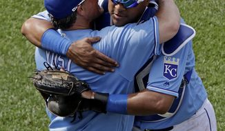 Kansas City Royals' Salvador Perez, right, and manager Ned Yost hug after the Royals defeated the Boston Red Sox 6-4 in a baseball game Wednesday, June 21, 2017, in Kansas City, Mo. The Royals won 6-4. (AP Photo/Charlie Riedel)