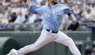 Kansas City Royals starting pitcher Ian Kennedy throws during the second inning of a baseball game against the Boston Red Sox Wednesday, June 21, 2017, in Kansas City, Mo. (AP Photo/Charlie Riedel)