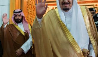 FILE -- In this April 5, 2017 file photo, released by the Saudi Press Agency, SPA, Saudi King Salman, right, and Defense Minister and Deputy Crown Prince Mohammed bin Salman wave as they leave the hall after talks with the British prime minister, in Riyadh, Saudi Arabia. Saudi King Salman has put his 31-year-old son, Mohammed bin Salman, next in line to take over the oil-rich kingdom with a royal decree Wednesday. (Saudi Press Agency via AP, File)