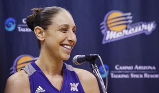 FILE - In this May 9, 2016, file photo, Phoenix Mercury's Diana Taurasi smiles as she speaks during a news conference at the team's basketball media day, in Phoenix. Still thriving at 35, a case could be made that the Phoenix Mercury guard is the greatest player in women's basketball history.  (AP Photo/Ross D. Franklin, File)